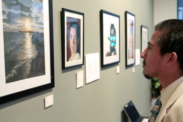 """Julio Campos of El Salvador looks at work by Cuban emmigrant Antonio Guerrero at the exhibition """"From My Altitude"""" that opened on Friday at Homewood Studios in Minneapolis.  Guerrero is currently incarcerated in Colorado for alleged acts of espionage against the United States."""