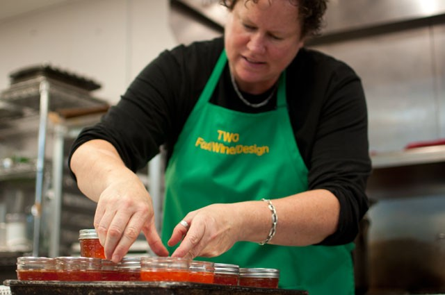 """Beth Fisher, last year's winner of the Chili Cook-Off at Midtown Global Market, cans her """"secret chili sauce"""" on Wednesday in preparation for Saturday's 4th Annual Chili Cook-Off."""
