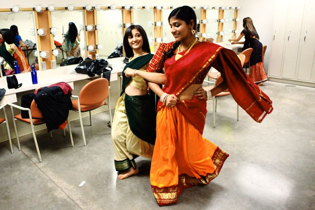 Sruti Velamakanni (left) and Prachi Mishra (right) practice their South Indian dance for the fashion show portion of the ISA Fall Show Friday evening at Tedd Mann Music Hall.