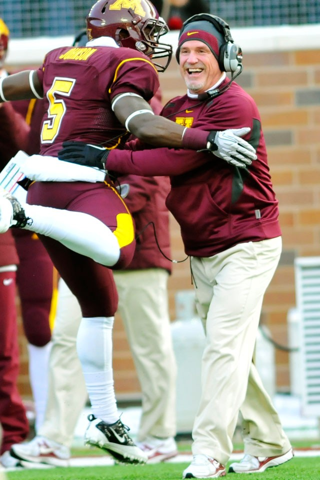 Sophomore MarQueis Gray embraces Interim Head Coach Jeff Horton on Saturday at the TCF Bank Stadium.