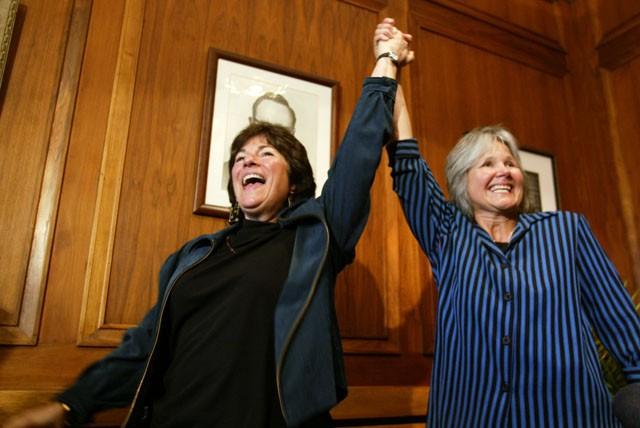 Marcia Kadish, left,and Tanya McCloskey react after being the first gay couple to be married in Cambridge, Mass., Monday, May 17, 2004, at at Cambridge City Hall.  Gay couples began exchanging marriage vows in Massachusetts on Monday, marking the first time a U.S. state has granted gays and lesbians the right to marry and making the United States one of a handful of countries where homosexuals can legally wed. (AP Photo/The Boston Globe, Dina Rudick)