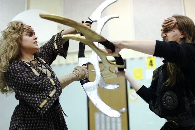 """Christina Romano left and and Zachary Serota right, rehearse for a fight scene in an upcoming production of """"A Klingon Christmas Carol"""" in North Minneapolis on Saturday."""