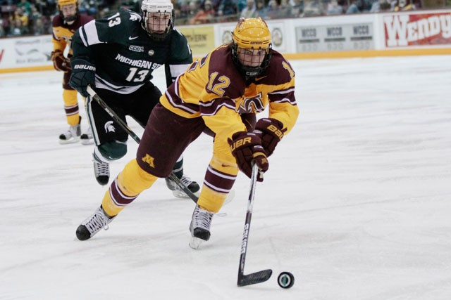 First year Justin Holl handles the puck against Michigan State on Friday at the Marriucci Arena.