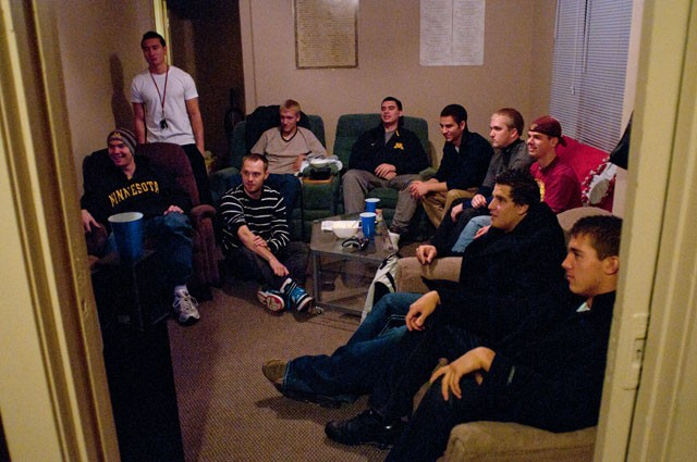 Members of the fraternity Phi Delta Theta hang out in their living room on Friday night in their house on 15th avenue.