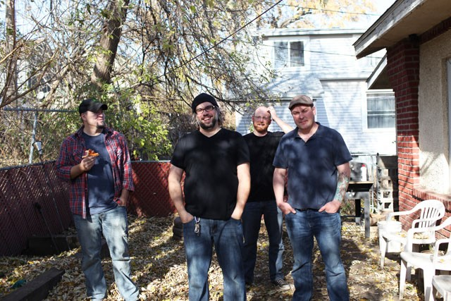 The Rockford Mules from left: Ryan Rud Erik Tasa, Joel Habedank and Craig Peck stand in the backyard of Craig's South Minneapolis home on Monday.