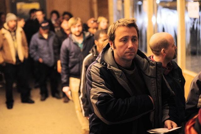 Mechanical engineering major Fabio Mariuci waits in line to retrieve his car Monday night at the Minneapolis Impound Lot.