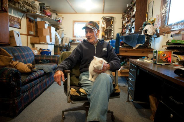 Richard Brand sits in the office of his farm that boarders Umore Park on Saturday in Rosemount, Minn.