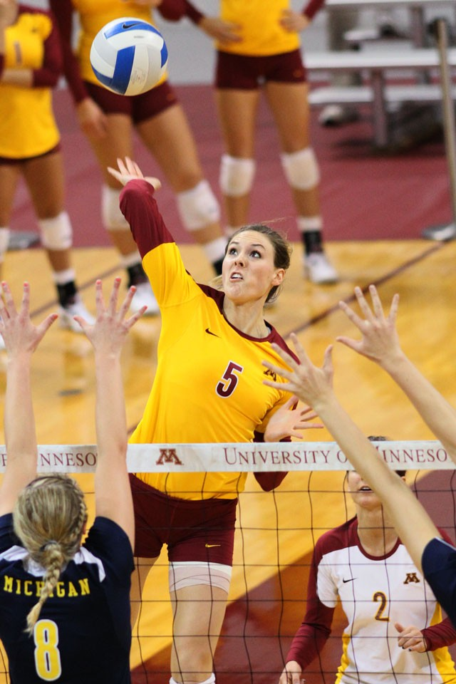 Senior middle blocker Lauren Gibbemeyer plays against Michigan Friday at the Sports Pavilion.
