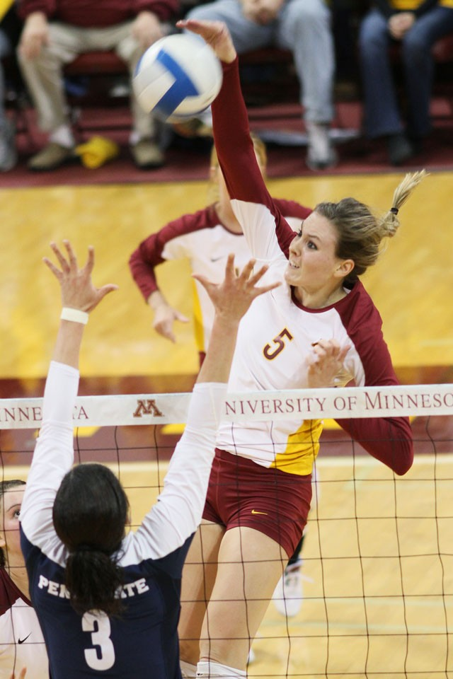 Senior middle blocker Lauren Gibbemeyer spikes the ball against Penn State Saturday at the Sports Pavilion.