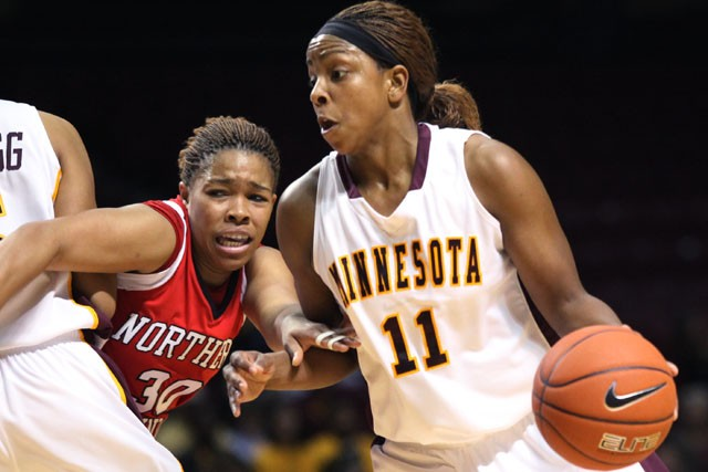 Sophomore guard Leah Cotton drives to the hoop with the help of her teammate, freshman forward Kionna Kellog, at Williams Arena on Saturday.