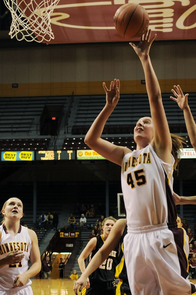 Junior forward Jackie Voigt attempts a basket against Milwaukee November 20 at Williams Arena.