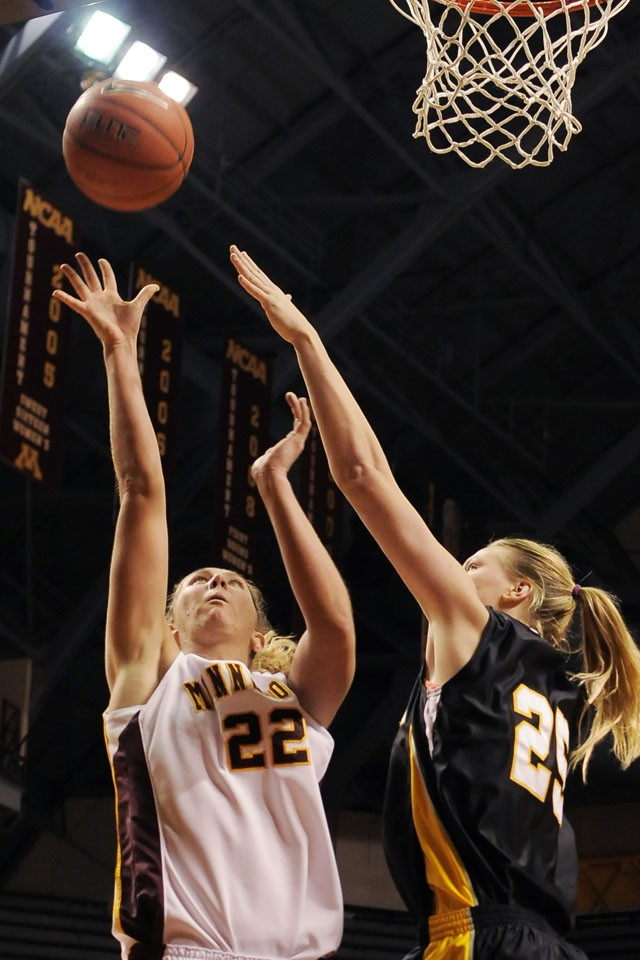 Senior forward Kristen Dockery attempts a basket against Milwaukee November 20 at Williams Arena.