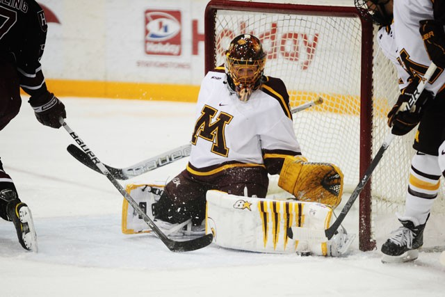 Goalie Noora Raty makes a save Friday night at Ridder Arena.  Raty saved all 12 shots she faced before being taken out of the game in the second period after taking a shot to the face.