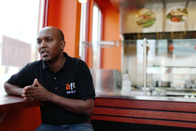 Abdirahan Kahine, owner of Afro Deli & Coffee talks about the grand opening of his deli in the West Bank area on Friday