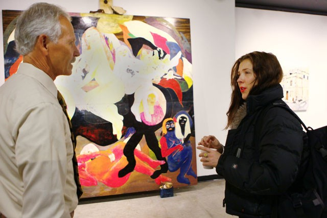 """Professor Jerald Krepps and Emma C Cook discuss her painting """"A Study of a Woman and a Horse"""" Friday evening in the Regis Center for Art."""
