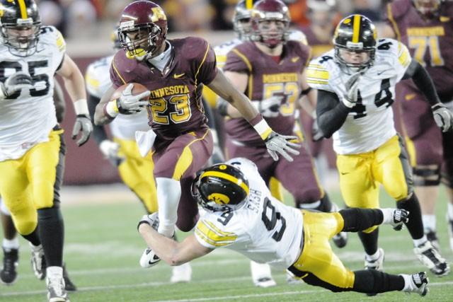 Junior running back DeLeon Eskridge attempts to break through Iowa's defense Saturday at TCF Bank Stadium.