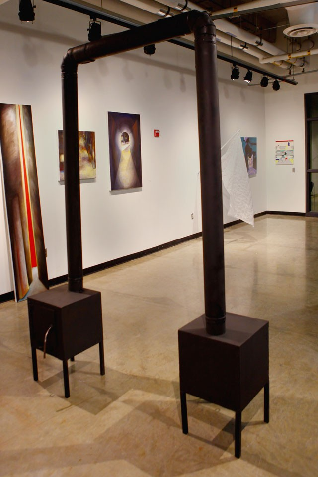 Eammon McClain's sculpture of stoves was on display in a Scholarship Exhibition held in the Regis Quarter Art Gallery Friday evening.