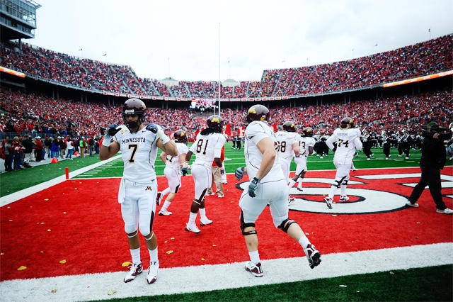 Gophers players run onto the field at their game against Ohio State.