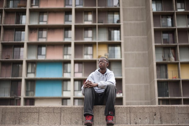Riverside Plaza resident Mohamed Jama, sits in the complex's courtyard on Monday in Minneapolis. Jama, 16, has lived in the plaza for six years and is the president of the Cedar Riverside Youth Council.