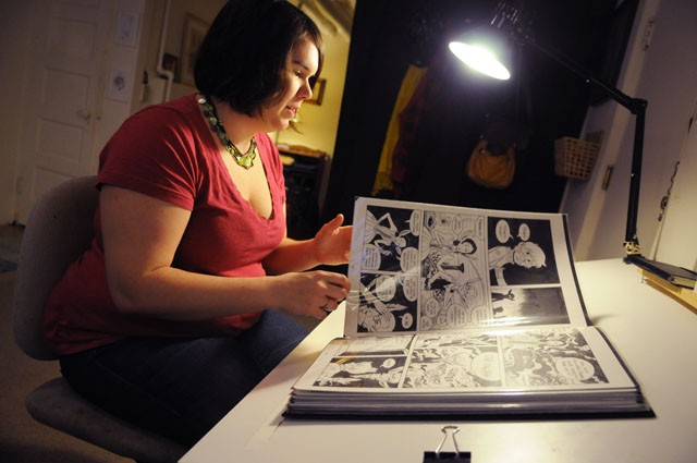 Local comic artist Brittney Sabo shows her work Tuesday at her studio apartment in south Minneapolis.  Sabo and co-author Anna Bratton's new comic book will be featured at Big Brain Comics following their book signing on Saturday.
