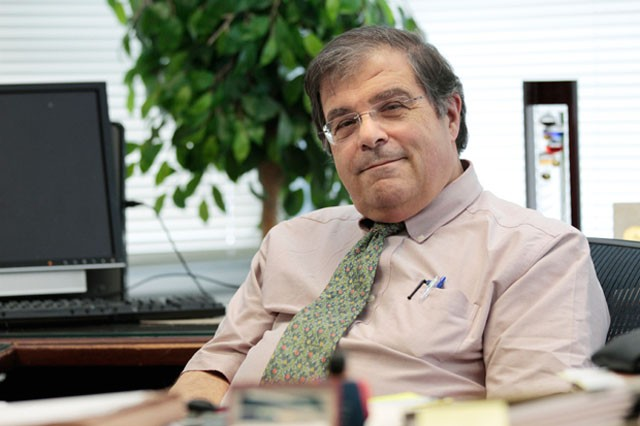 Academic Health Center Vice President and Medical School Dean Frank Cerra takes a break on Friday in his office at the Child Rehab Center.