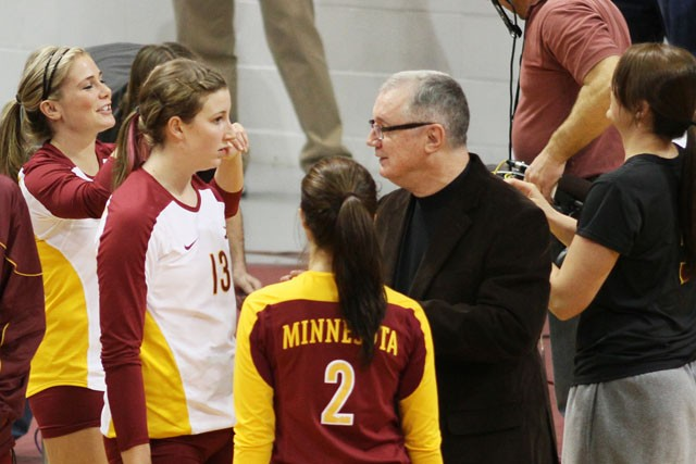 Volleyball head coach Mike Hebert speaks to his team during their game against Penn State November 27 at the Sports Pavilion.