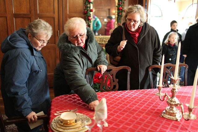 Katherine Langdon, left, Mary Ellison, center, and Wendy Hain, right look at displays at the governors mansion on Tuesday in St. Paul.