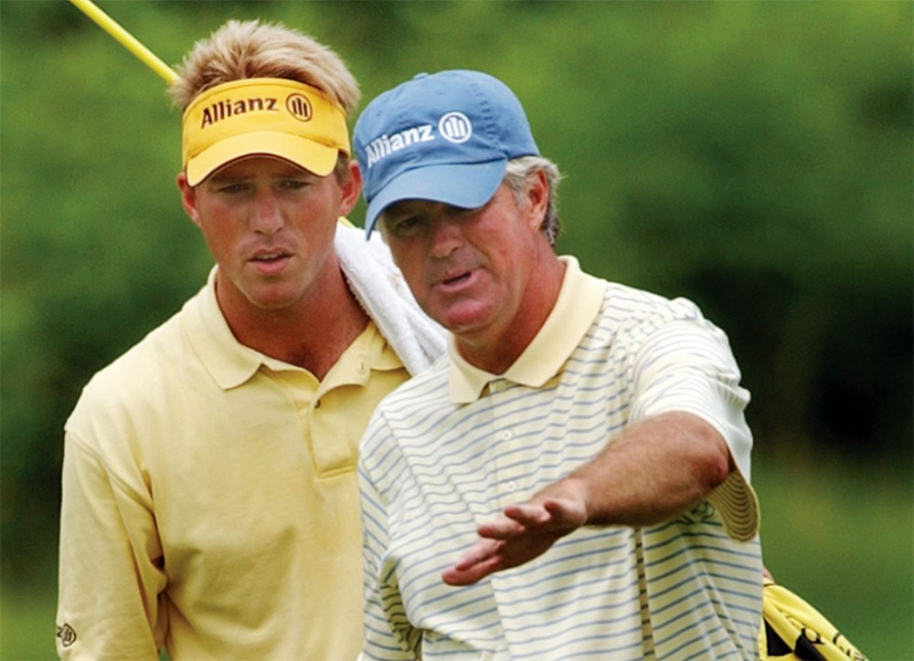 John Harris, right, lines up a putt with his current son-in-law and caddie, Ernie Rose, at a Champions Tour event in 2004. Sources say Harris let Rose coach the Gophers women's golf team without the official title of head coach, in violation of University policy.