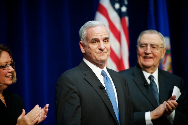 Governor Mark Dayton, center, stands beside Lieutenant Governor Yvonne Prettner Solon, left, and former Vice President Walter Mondale after being sworn into office Monday at Landmark Center.
