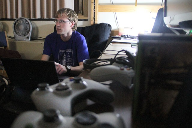 First year computer science student Derek Anderson plays computer games on Monday in his dorm room. The the U.S. army is currently looking to use the research to advance training for soldiers by using the teamwork aspect of MMORPG games to improve communication and work towards a common goal.