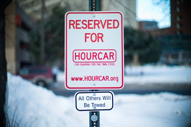 A HOURCAR sign stands in one of Augsburg College Parking Lot. Students of University of Minnesota who live in the Southeast Como neighborhood will soon be having the car sharing service.