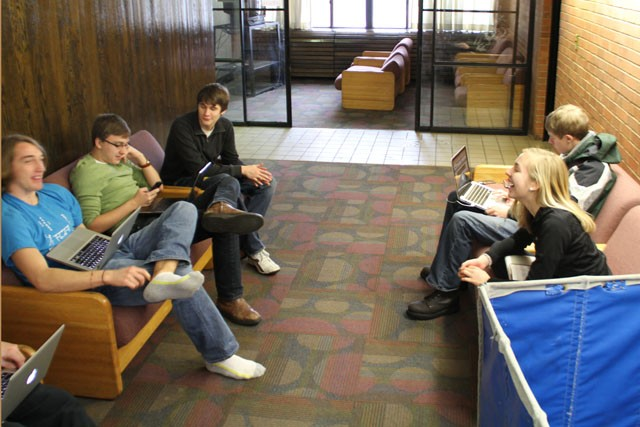 Casey Skalbeck, Mark Kruze, and Danie Feld relax in the lounge of their Arts Living Learning Community floor in Middlebrook Hall with other students who share similar majors and interests.