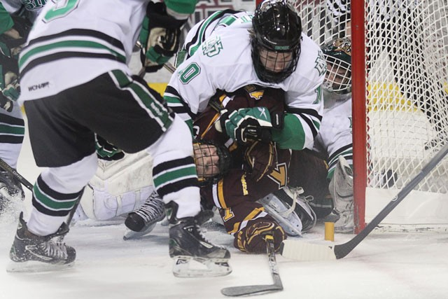 Senior forward Jacob Cepis fights the action in the crease on Friday in the gophers 3-2 win against the UND Fighting Sioux in Grand Forks, North Dakota. The two teams tied the series 1-1.