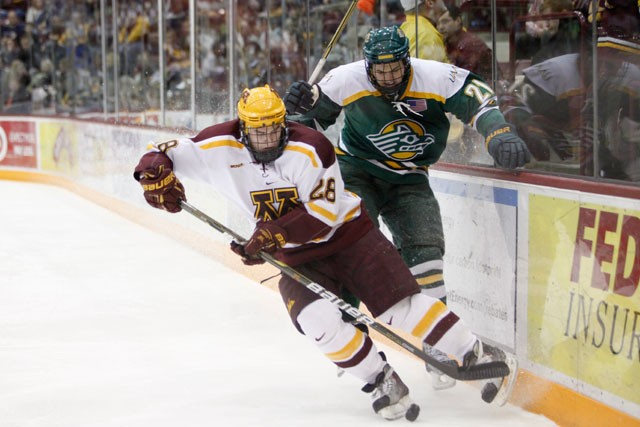 Gophers defender Cade Fairchild fights for the puck against Anchorage forward Matt Bailey on Saturday at Mariucci Arena. The Gophers lost to Anchorage by one point.