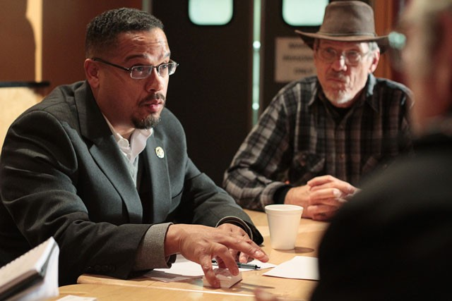 """Congressman Keith Ellison, D-Minn., speaks with citizens while holding a """"Congress on Your Corner"""" event on Friday at the Midtown Global Market."""