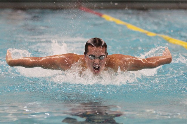 Freshman Kyler Van Swol swims the men's 200 butterfly against the University of Missouri on Saturday at the Aquatic Center.  Van Swol took gold in both the 200 backstroke and the 100 butterfly.