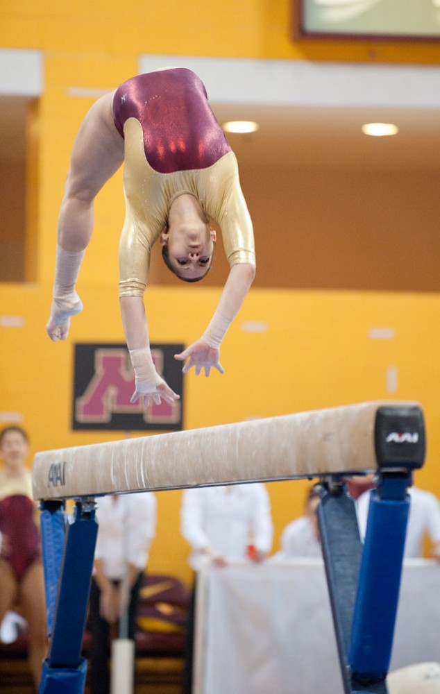 Gopher's senior Ana Balboa competes on the high beam against Iowa on Saturday in the Sports Pavilion.