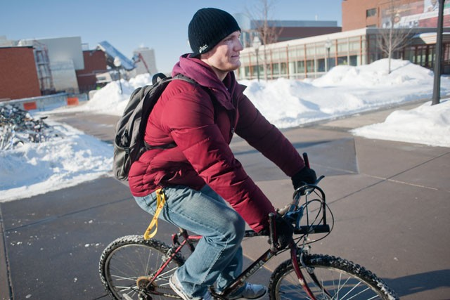 Sophomore Kevin Steinhaus bikes to class Wednesday past Coffman Union.