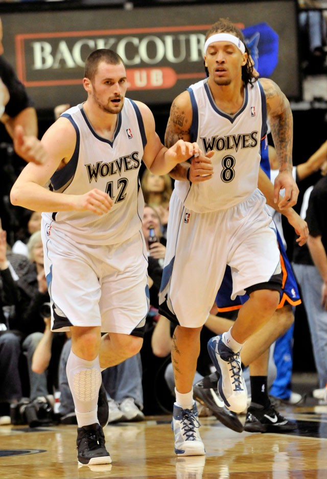 Minnesota Timberwolves' Kevin Love, left, is congratulated by Michael Beasley after a shot in the second half of an NBA basketball game Friday, Nov. 12, 2010 in Minneapolis. Love scored 31 points and had 31 rebounds while Beasley scored 35 to lead the Timberwolves in their 112-103 win over the New York Knicks.  (AP Photo/Jim Mone)