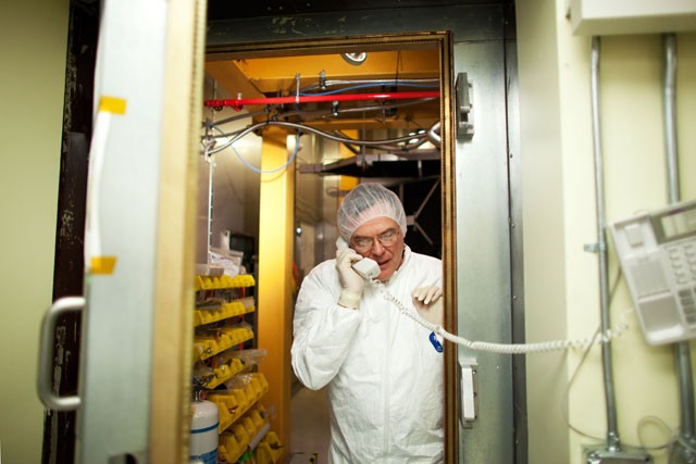 Senior Engineer of Soudan Underground Lab James Beaty talks on the phone with his colleague in the Cryogenic Dark Matter Search (CDMS) cleanroom. The CDMS searches for