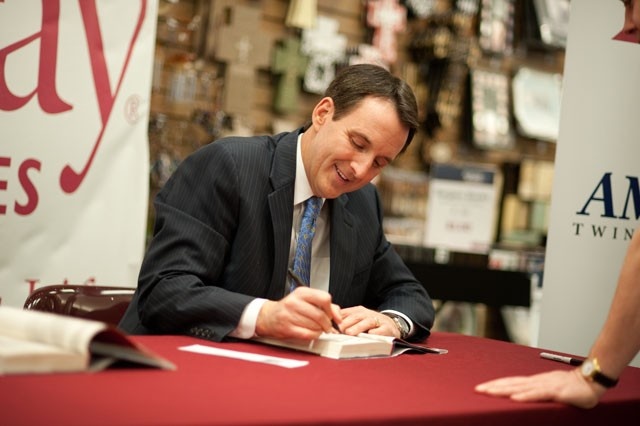 Former Minnesota Gov. Tim Pawlenty signs copies of his book on Jan. 27 in Burnsville, Minn.