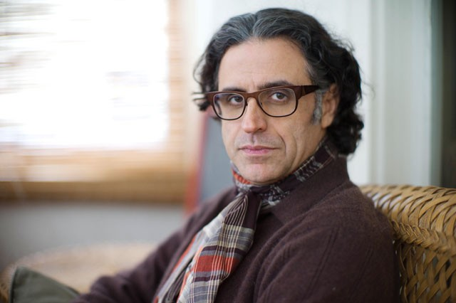 Film professor Hisham Bizri sits at his front porch Monday in St Paul. His latest script won an award in the 34th Cairo International Film Festival and will be filmed in early 2012.