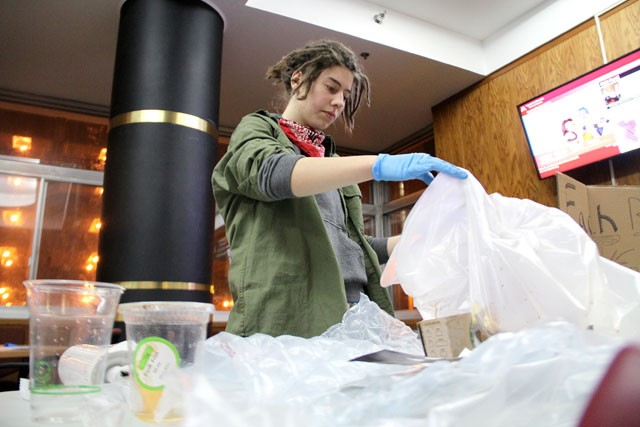Sustainability sophomore Rosalyn Murphy sorts through Centennial Hall's trash Monday during the Conservation Madness kick off at the dorm. Between February 7-20th, all residence halls will be competing against each other to increase recycling and reduce their electricity usage, with the winning dorm earning a national basketball tailgate party.