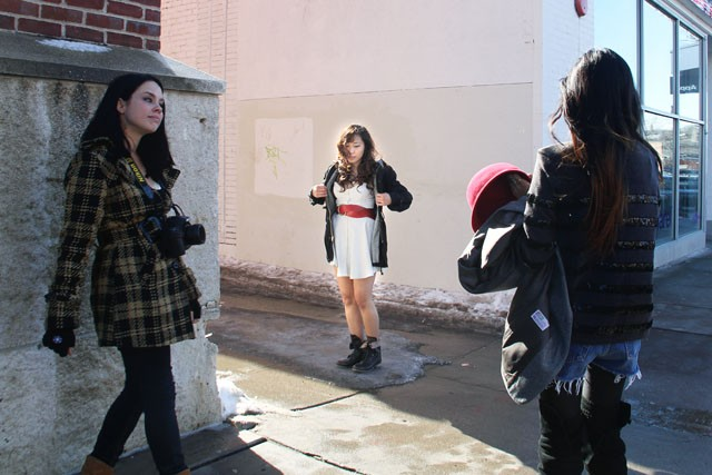 Secrets Fashion Agency owner and senior Angel Yang, center, models Frances Zerr's designs, for photographer Wynona Grey, left, on Sunday in Calhoun Square. The one year-old agency consist of stylists who work to bridge the gap between designers and consumers in the Minneapolis area.