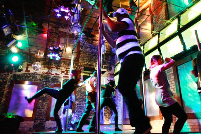 90's regular Robert Jorge pole dances on the stage Saturday night at Gay 90's. Gay 90's is one of the Premier Bars in Downtown Minneapolis