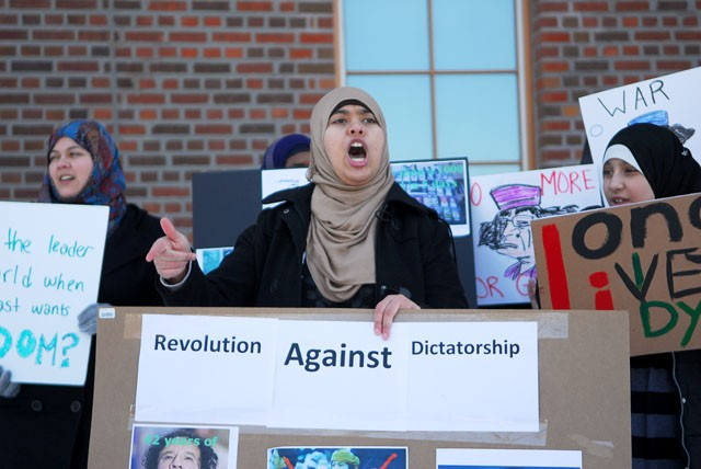 Sara Milad demonstrates with others on Tuesday outside of Coffman Union. The demonstrations were against Libya's current dictator Muammar al-Gaddafi who has ruled for 42 years. Over 600 Libyan people have been killed in recent protests in the country.