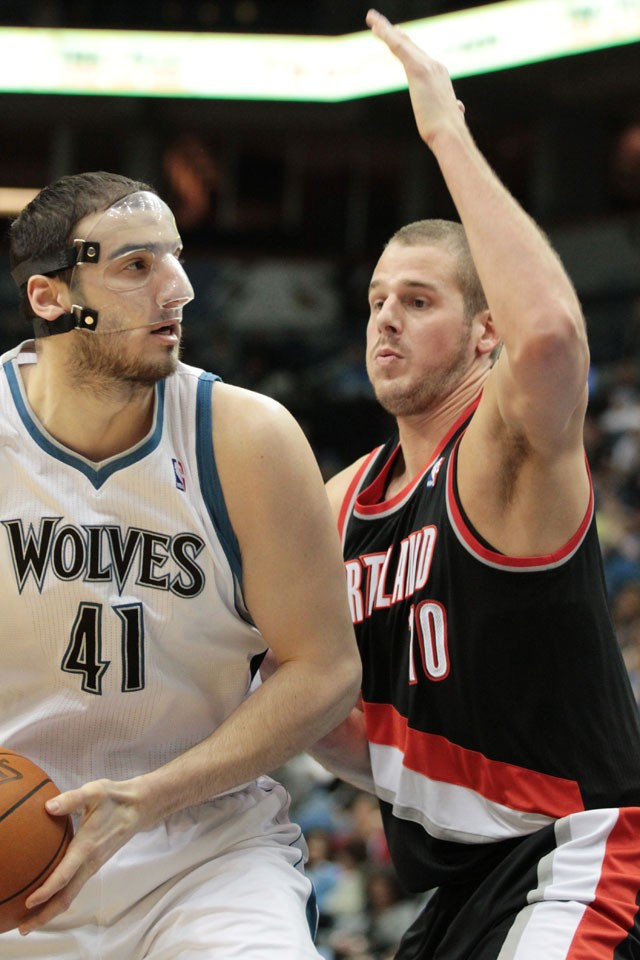 Trailblazer Joel Przybilla, right, guards Minnesota Timberwolves forward Kosta Koufos Monday night at the Target Center.  Przybilla left the Gophers during his sophomore year to pursue a career in the NBA.
