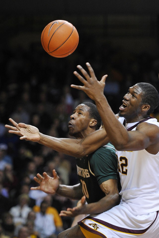 Gophers junior forward Trevor Mbakwe tussels with Spartans junior forward Delvon Roe Tuesday at Williams Arena.  The Spartans defeated the Gophers 53 to 48.