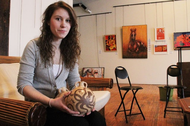 Artist Kate Johnson holds her clay jar Saturday that will be on display in the Online (Dis)connect exhibit at Altered Esthetics from February 3-Feburary 24. This group exhibit addresses modern online social networking and communication.
