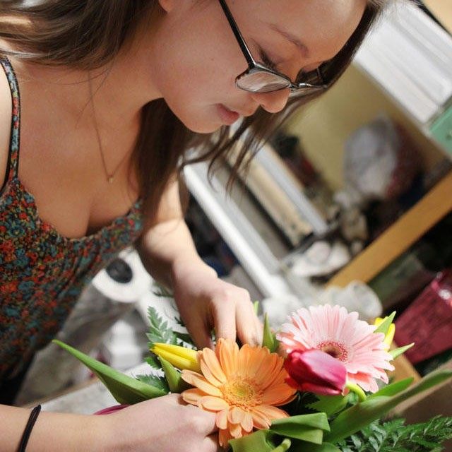 Haley Hamman creates floral arrangements for pre-Valentine's Day orders Wednesday at Sheffield's Floral on Washington Avenue.